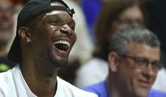 Miami Heat forward Chris Bosh smiles during the first half of an NCAA college basketball game between Miami and Duke in Coral Gables, Fla., on Saturday, Feb. 25, 2017. (David Santiago /El Nuevo Herald via AP)