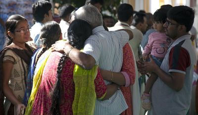 "Relatives grieve as last rites are performed on Srinivas Kuchibhotla, a 32-year-old engineer who was killed in an apparently racially motivated shooting in a crowded Kansas bar, at his residence in Hyderabad, India, Tuesday, Feb.28, 2017. According to witnesses, the gunman yelled ""get out of my country"" at Kuchibhotla and Alok Madasani before he opened fire at Austin's Bar and Grill in Olathe, Kansas, a suburb of Kansas City, on Wednesday evening. Both men had come to the U.S. from India to study and worked as engineers at GPS-maker Garmin. (AP Photo/Mahesh Kumar A.)"