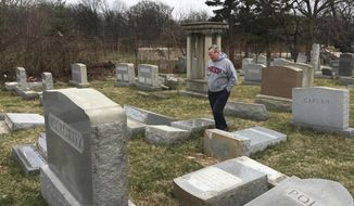 "Philadelphia Mayor Jim Kenney surveys the damage at Mount Carmel Cemetery, Monday, Feb. 27, 2017, in Philadelphia. Police investigated what they called an ""abominable crime"" after several hundred headstones were damaged during the weekend at the Jewish cemetery dating to the late 1800s, said Steven Rosenberg, chief marketing officer of the Jewish Federation of Greater Philadelphia. (David Swanson/The Philadelphia Inquirer via AP)"