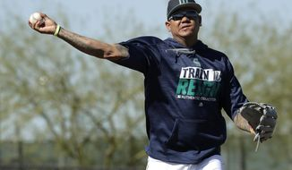 FILE - In this Feb. 15, 2017, file photo, Seattle Mariners pitcher Felix Hernandez participates in a drill during spring training baseball practice in Peoria, Ariz. Hernandez is beginning his climb back from one of his toughest seasons, when he went 11-8 with a 3.82 ERA and his lowest innings total since 2007. (AP Photo/Charlie Riedel, File)