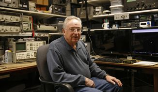 In this Feb. 21, 2017 photo, lifelong ham radio operator and expert tinkerer Tom Thompson poses for  a photo inside his basement home office, where he operates a ham radio and other devices in Boulder, Colo. After discovering that radio interference was being caused by high-powered lights from home marijuana growers, Thompson built an electronic filter and has given them to nearby growers. (AP Photo/Brennan Linsley)
