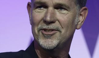Founder and CEO of Netflix Reed Hastings speaks during a keynote at the Mobile World Congress in Barcelona, Spain, Monday, Feb. 27, 2017. The Mobile World Congress will be held 27 Feb. to 2 March. (AP Photo/Manu Fernandez)