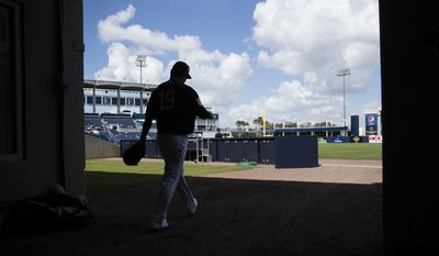 New York Yankees starting pitcher Masahiro Tanaka walks onto the field ahead of a spring training baseball game against the Detroit Tigers Tuesday, Feb. 28, 2017, in Tampa, Fla. (AP Photo/Matt Rourke)