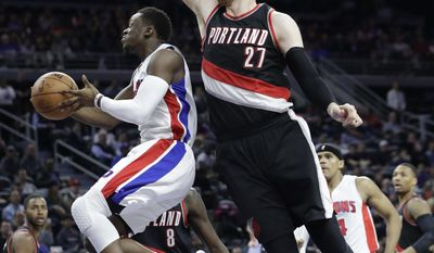 Detroit Pistons guard Reggie Jackson, left, makes a layup defended by Portland Trail Blazers center Jusuf Nurkic (27) during the first half of an NBA basketball game, Tuesday, Feb. 28, 2017, in Auburn Hills, Mich. (AP Photo/Carlos Osorio)