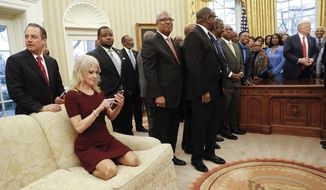 President Donald Trump, right, meets with leaders of Historically Black Colleges and Universities (HBCU) in the Oval Office of the White House in Washington, Monday, Feb. 27, 2017. Also at the meeting are White House Chief of Staff Reince Priebus, left, and Counselor to the President Kellyanne Conway, on the couch. (AP Photo/Pablo Martinez Monsivais)
