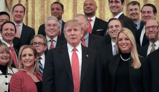 President Donald Trump poses for a photo with the National Association of Attorneys General, Tuesday, Feb. 28, 2017, in the East Room of the White House in Washington. (AP Photo/Pablo Martinez Monsivais)