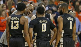 FILE - In this Jan. 8, 2017, file photo, Wake Forest head coach Danny Manning directs his team during the second half of an NCAA college basketball game against Virginia in Charlottesville, Va. Wake Forest has made undeniable progress in coach Danny Manning's third year. Entering Wednesday's home finale against No. 8 Louisville, the question now is whether the Demon Deacons can do enough to secure the program's first NCAA Tournament bid since 2010 behind an ACC player of the year candidate in sophomore John Collins.  (AP Photo/Steve Helber)
