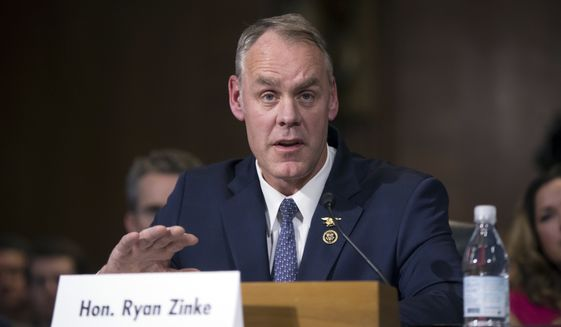 In this Jan. 17, 2017, file photo, Interior Secretary-nominee, Rep. Ryan Zinke, R-Mont., testifies on Capitol Hill in Washington. (AP Photo/J. Scott Applewhite, File)