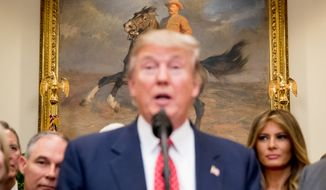 A painting of former President Teddy Roosevelt is displayed above Environmental Protection Agency (EPA) Administrator Scott Pruitt, left, and first lady Melania Trump, right, as President Donald Trump speaks before signing the Waters of the United States (WOTUS) executive order in the Roosevelt Room in the White House, Tuesday, Feb. 28, 2017, in Washington, which directs the Environmental Protection Agency to withdraw the Waters of the United States (WOTUS) rule, which expands the number of waterways that are federally protected under the Clean Water Act. (AP Photo/Andrew Harnik)