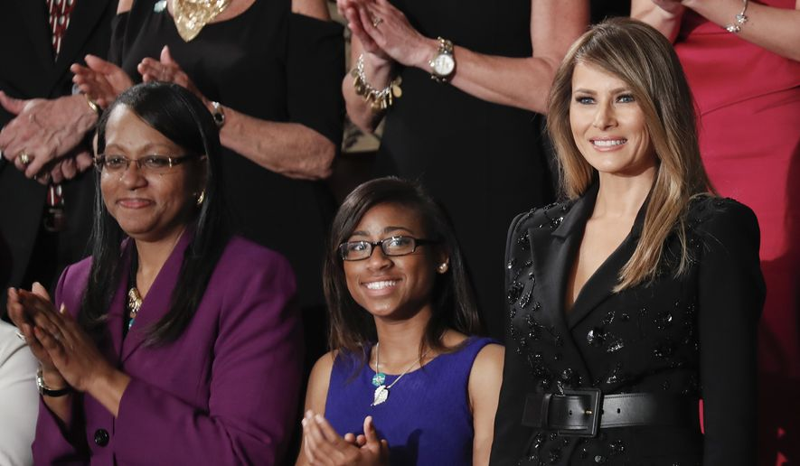 Jessica Gregory, 18, center and her mother Sheila Gregory, left, applaud the arrival of first lady Melania Trump, right, on Capitol Hill in Washington, Tuesday, Feb. 28, 2017, for President Donald Trump's speech to a joint session of Congress. (AP Photo/Pablo Martinez Monsivais)