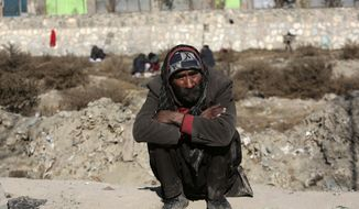 In this Dec. 21, 2016, photo, An Afghan drug addict waits to receive first aid for his wounds from Bridge Hope Health Organization (BHHO)  during a campaign to help drug users get care and counseling, in Kabul, Afghanistan. A small group of former addicts is trying to help drug users in Afghanistan, a country with one of the highest rates of addiction in the world. Thousands can be found in the streets of the capital, Kabul, sleeping under bridges, as the government struggles to provide services and rein in cultivation of poppies that produce opium and heroin. (AP Photo/Rahmat Gul)