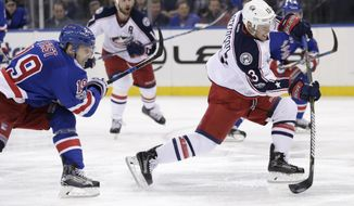 Columbus Blue Jackets' Cam Atkinson, right, scores during the third period of the NHL hockey game against the New York Rangers, Sunday, Feb. 26, 2017, in New York. The Blue Jackets defeated the Rangers 5-2. (AP Photo/Seth Wenig)