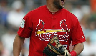 St. Louis Cardinals third baseman Jhonny Peralta (27) reacts after throwing out a New York Mets base runner in a spring training baseball game Wednesday, March 1, 2017, in Jupiter, Fla. After an injury-riddled season a year ago, Peralta enters this spring looking for playing time anywhere he can get it. (AP Photo/John Bazemore)