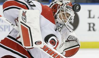 Carolina Hurricanes goalie Eddie Lack (31) makes a save on a shot by the Tampa Bay Lightning during the second period of an NHL hockey game Wednesday, March 1, 2017, in Tampa, Fla. (AP Photo/Chris O'Meara)