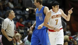 Atlanta Hawks forward Ersan Ilyasova (7), of Turkey, reacts after a 3-point basket while Dallas Mavericks forward Dirk Nowitzki (41), of Germany, yells at referee Monty McCutchen (13) during the second half of an NBA basketball game, Wednesday, March 1, 2017, in Atlanta. Atlanta won 100-95. (AP Photo/AJ Reynolds)