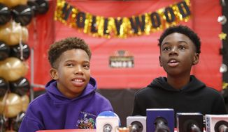 "Jaden Piner, left, 13, and Alex Hibbert, 12, speak about what it was like to be at the Academy Awards for their part in the film ""Moonlight,"" during a news conference at Norland Middle School, Wednesday, March 1, 2017, in Miami Gardens, Fla.  The film garnered three Oscars Sunday night, including the award for best picture. (AP Photo/Wilfredo Lee)"