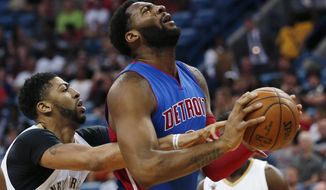 Detroit Pistons center Andre Drummond is fouled by New Orleans Pelicans forward Anthony Davis, left, as he goes to the basket during the first half of an NBA basketball game in New Orleans, Wednesday, March 1, 2017. (AP Photo/Gerald Herbert)