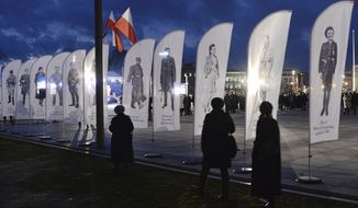 Warsaw residents attend state ceremonies in honor of clandestine anti-communist fighters of the post-World War II era in Pilsudski Square in Warsaw, Poland, Wednesday, March 1, 2017. Poland's Home Army soldiers who fought the German Nazis during the war, continued their struggle after 1945 against the communist regime imposed on Poland then. Many were arrested and killed by the communist regime. (AP Photo/Czarek Sokolowski)