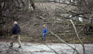 Niles residents check out the damage and begin to clean up after strong storms hit Monday night in a neighborhood near Niles High school Wednesday, March 1, 2017, in Niles, Mich. (Santiago Flores/South Bend Tribune via AP)