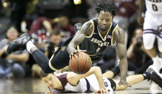 Wichita State forward Zach Brown gets fouled by Missouri State forward Jarrid Rhodes after chasing a loose ball during the first of their game at Missouri State in Springfield, Mo., Saturday, Feb. 25, 2017.  (Fernando Salazar/The Wichita Eagle via AP)