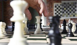 This photo taken Feb. 24, 2017, shows students practicing chess after school at the Franklin Chess Center in Meadville, Miss.  (Elijah Baylis/The Clarion-Ledger via AP)