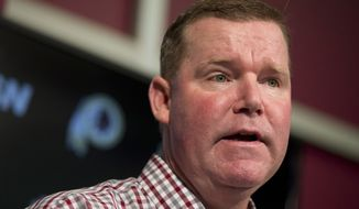 FILE - In this April 25, 2016 file photo, Washington Redskins' general manager Scot McCloughan speaks during a news conference at Redskins Park in Ashburn, Va. McCloughan is not attending the NFL combine in Indianapolis. Team spokesman Tony Wyllie confirmed that in an email to The Associated Press. He said McCloughan is taking care of some family matters.  (AP Photo/Manuel Balce Ceneta, File)