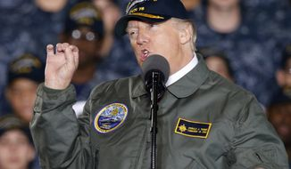 President Donald Trump gestures as he speaks to Navy and shipyard personnel aboard nuclear aircraft carrier Gerald R. Ford at Newport News Shipbuilding in Newport News, Va., Thursday, March 2, 2017. The ship which is still under construction is due to be delivered to the Navy later this year. (AP Photo/Steve Helber)