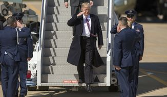 President Donald Trump steps off Air Force One at Langley Air Force Base in Hampton, Va., Thursday, March 2, 2017 for his first visit to the Hampton Roads area since taking office in January. The purpose of his visit was to deliver a speech in the hangar bay of the aircraft carrier Ford at Newport News Shipbuilding. (Bill Tiernan/The Virginian-Pilot via AP)