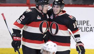 Ottawa Senators' Alexandre Burrows (14) celebrates his second goal of the night against the Colorado Avalanche with teammate Dion Phaneuf (2), during the second period of an NHL hockey game Thursday, March 2, 2017, in Ottawa, Ontario. (Justin Tang/The Canadian Press via AP)
