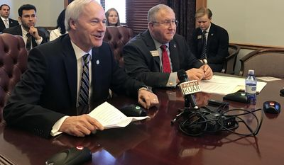 Arkansas Gov. Asa Hutchinson, left, and Sen. Dave Wallace speak to the Senate Education Committee Thursday, March 2, 2017, in Little Rock about a proposal to remove Confederate Gen. Robert E. Lee from the state holiday honoring slain civil rights leader Martin Luther King Jr. (AP Photo/Andrew DeMillo)