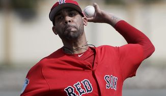FILE - In this Feb. 19, 2017, file photo, Boston Red Sox pitcher David Price throws a live batting session at a spring training baseball workout in Fort Myers, Fla. Red Sox left-hander David Price was scratched from his first spring training start and will consult with specialists after experiencing soreness in his left forearm and elbow.  (AP Photo/David Goldman, File)
