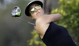 Michelle Wie of the United States tees off on the third hole during the first round of the HSBC Women's Champions golf tournament held at Sentosa Golf Club's Tanjong course on Thursday, March 2, 2017, in Singapore. (AP Photo/Wong Maye-E)