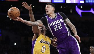 FILE - In this Feb. 14, 2017, file photo, Sacramento Kings' Matt Barnes, right, shoots next to Los Angeles Lakers' Nick Young during the second half of an NBA basketball game in Los Angeles. The Golden State Warriors announced Thursday, March 2, 2017, they have signed Barnes, bringing the edgy veteran in after losing Kevin Durant to a knee injury.  (AP Photo/Jae C. Hong, File)