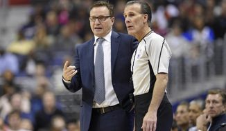Washington Wizards head coach Scott Brooks, left, talks with referee Ken Mauer (41) during the first half of an NBA basketball game against the Golden State Warriors, Tuesday, Feb. 28, 2017, in Washington. (AP Photo/Nick Wass)