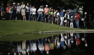 Spectators watch across a lake at the 6th hole, during round one of the Mexico Championship at Chapultepec Golf Club in Mexico City, Thursday, March 2, 2017. All but one of the world's top 50 golfers are contesting the World Golf Championship PGA event, which this year relocated to Mexico City from the Trump National Doral Resort in Florida. (AP Photo/Rebecca Blackwell)