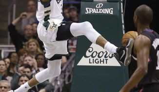 Milwaukee Bucks' Giannis Antetokounmpo dunks in front of Los Angeles Clippers' Luc Richard Mbah a Moute during the first half of an NBA basketball game Friday, March 3, 2017, in Milwaukee. (AP Photo/Jeffrey Phelps)