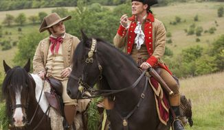 """This image released by Disney shows Josh Gad as Le Fou, left, and Luke Evans as Gaston in a scene from, """"Beauty and the Beast,"""" opening nationwide on March 17. (Laurie Sparham/Disney via AP)"""