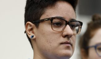 Daniela Vargas, whose father and brother were picked up during a recent immigration raid of undocumented immigrants listens as speakers discuss the series of raids that also picked up other undocumented immigrants across the state during a news conference at the Jackson, Miss., city hall, Wednesday, March 1, 2017. Vargas was detained by ICE agents following the news conference. A college student, Vargas hopes to continue her education but fears for the fate of other undocumented immigrant families. (AP Photo/Rogelio V. Solis)