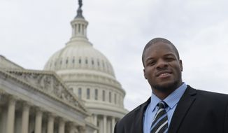 """In this photo taken Feb. 28, 2017, Tennessee Titans lineman Karim Barton, who is doing an NFLPA """"externship,"""" poses for a photo on Capitol Hill in Washington. Barton has taken part in NFLPA """"externships"""" with UnderArmour, Fanatics and Mattress Firm, but his strongest foray into the real world comes working with Rep. Yvette Clarke, D-N.Y. on Capitol Hill. Barton aims to keep his options open for his post-playing career and hopes political work opens up new doors for him after football. (AP Photo/Susan Walsh)"""