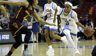 UCLA guard Jordin Canada (3) drives to the hoop under pressure from Arizona State guard Kiara Russell, left, in the first half of an NCAA college basketball game in the Pac-12 Conference tournament, Friday, March 3, 2017, in Seattle. (AP Photo/Ted S. Warren)