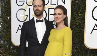 FILE - In this Jan. 8, 2017 file photo, Benjamin Millepied, left, and Natalie Portman arrive at the 74th annual Golden Globe Awards in Beverly Hills, Calif.  A representative for the Oscar-winning actress said Friday, March 3, that Portman and her husband Benjamin Millepied welcomed daughter Amalia Millepied, on Feb. 22. (Photo by Jordan Strauss/Invision/AP, File)