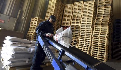 FOR RELEASE SATURDAY, MARCH 4, 2017, AT 12:01 A.M. MST.- Stacks of empty pallets sit ready to be used as Marino Villarreal continues preparing bags of beans for shipping on Feb. 21 at Northern Feed and Bean, 235 E 1st St., in Ault, Colo. (Joshua Polson /The Greeley Tribune via AP)