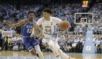 North Carolina's Justin Jackson (44) drives to the basket while Duke's Matt Jones (13) defends during the first half of an NCAA college basketball game in Chapel Hill, N.C., Saturday, March 4, 2017. (AP Photo/Gerry Broome) **FILE**