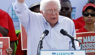 """U.S. Sen. Bernie Sanders, I-Vt, tells thousands at a pro-union rally near Nissan Motor Co.'s Canton, Miss., plant, Saturday, March 4, 2017, that he congratulates workers for their courage """"in standing up for justice."""" Participants marched to the plant to deliver a letter to the company demanding the right to vote on union representation to address better wages, safe working conditions and job security. (AP Photo/Rogelio V. Solis)"""