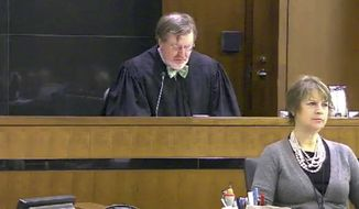 FILE - This March 12, 2013 file still image taken from United States Courts shows Judge James Robart listening to a case at Seattle Courthouse in Seattle. Robart has granted an extension to the Justice Department in a lawsuit alleging that President Donald Trump's immigration order is blocking efforts by legal residents to reunite with their children who are trapped in war-torn countries. Robart also said he understood the frustrations of plaintiffs over Trump administration statements that seemingly contradict those made by federal government lawyers. After being repeatedly postponed, a White House official said Thursday, March 2, 2017, a replacement order now won't be unveiled until next week at the earliest. (United States Courts via AP, File)