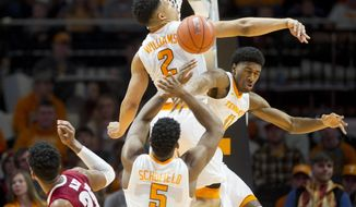 Tennessee's Grant Williams (2), Kyle Alexander (11) and Admiral Schofield (5) block a shot by Alabama's Braxton Key (25) during an NCAA college basketball game Saturday, March 4, 2017, at Thompson-Boling Arena in Knoxville, Tenn. (Calvin Mattheis/Knoxville News Sentinel via AP)