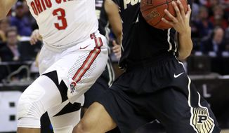Purdue guard Ashley Morrissette, right, drives to the basket defended by Ohio State guard Kelsey Mitchell (3) during the first half of an NCAA college basketball game in the semifinals of the Big 10 conference tournament, Friday, March 4, 2017, in Indianapolis. (AP Photo/R Brent Smith)