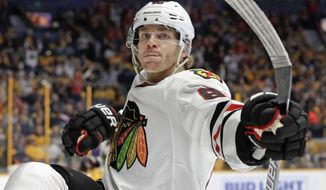 Chicago Blackhawks right wing Patrick Kane celebrates after scoring a goal against the Nashville Predators during the first period of an NHL hockey game Saturday, March 4, 2017, in Nashville, Tenn. (AP Photo/Mark Humphrey)
