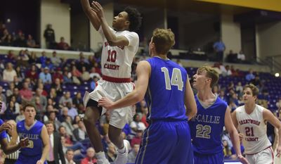 Brentwood Academy's Darius Garland (10) shoots past McCallie School's Seth Clark (14) and Trip Butler (22) during the second half of the Tennessee Division II AA boys' high school basketball championship game Saturday, March 4, 2017, in Nashville, Tenn. (AP Photo/Mike Strasinger)