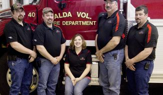 ADVANCE FOR WEEKEND EDITIONS MARCH 4-5 - In this Feb. 16, 2017 photo, Chance Miles, from left, Colt Miles, Chanda Bowers, Ron Miles and Blake Bowers make up a quarter of the Alda Volunteer Fire Department in Alda, Neb.. Together they have over 80 years of firefighting experience. (Zach Mayhew/The Independent via AP)